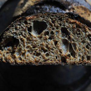 malted flour sourdough loaf cut in half