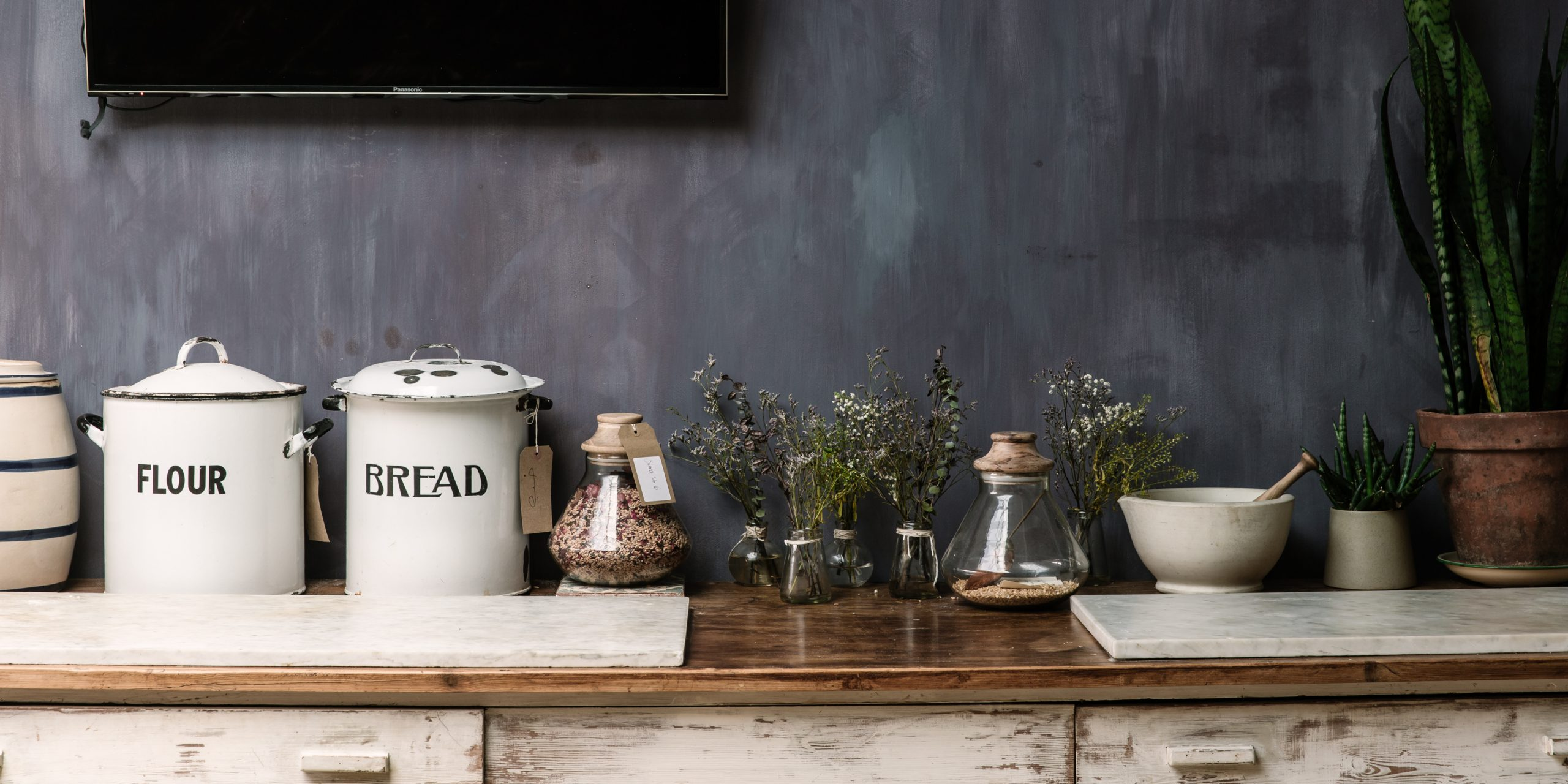the sourdough sc cool workbench with botanical blends on glass jars